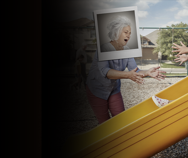 Grandma looking exhausted while playing with young child on slide